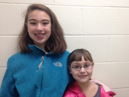 Lily Augustine, 11, left, and Eliza Augustine, 8, of Victor.