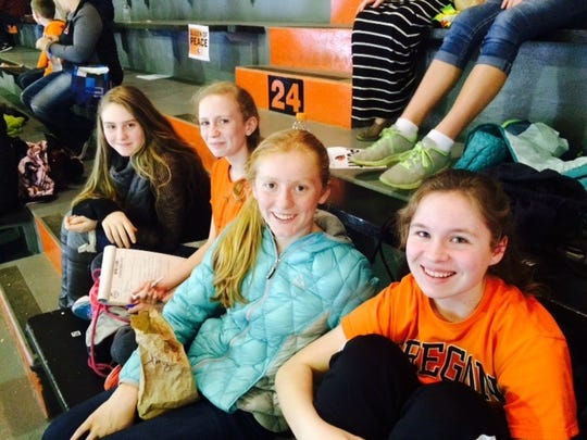 Victor Point 7th-graders are all smiles as they take in an Oregon State University women's basketball game at Gill Coliseum as part of Beavers Beyond the Classroom, when thousands of students visited campus Tuesday, Dec. 15.