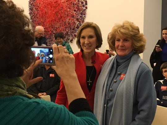 Carly Fiorina poses for a picture with supporters at a reception in Davenport Friday, Dec. 18.