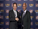 LSU coach Les Miles (left) shakes hands with new defensive coordinator Dave Aranda.