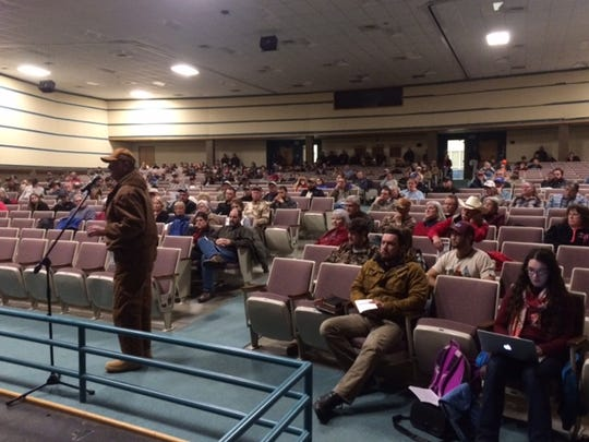 Haywood County Farm Bureau president address the N.C. Wildlife Resources Commission Tuesday night at Haywood Community College in support of a plan to open elk to hunting.