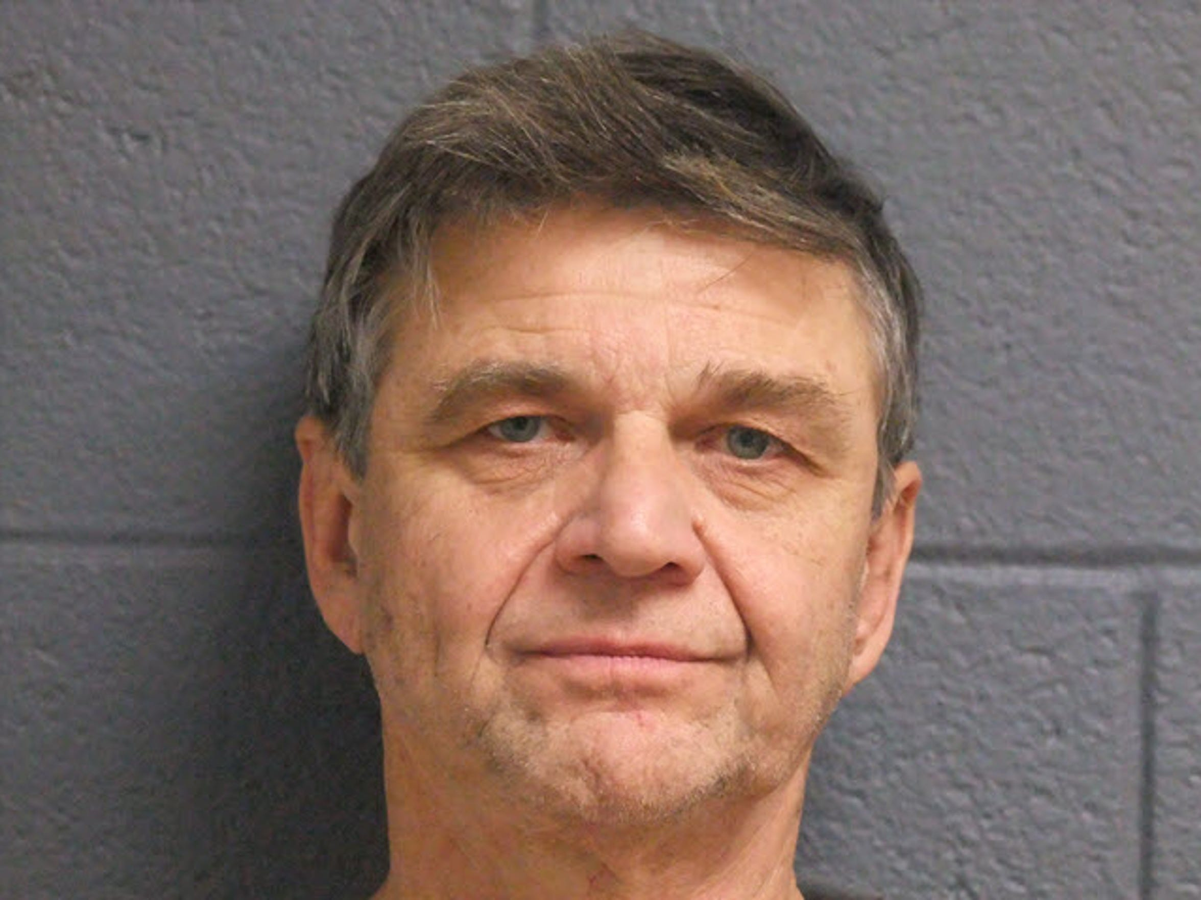 Erv Brinker in his mugshot taken Jan. 15. The former