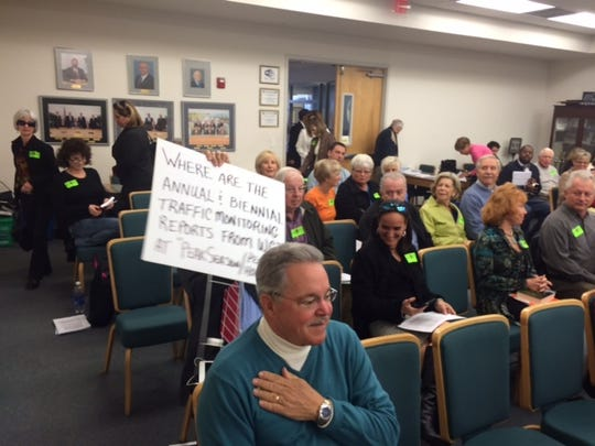 Citizens opposed to  the proposal for construction of four 22 story towers at Raptor Bay turned out  to protest the plans at a Bonita Springs City Council meeting Wednesday morning.
