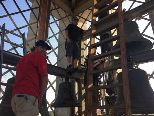 Crews work to renovate the steeple bells at First Baptist