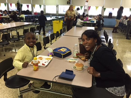 School 5 student Tristan Pendleton enjoys lunch with