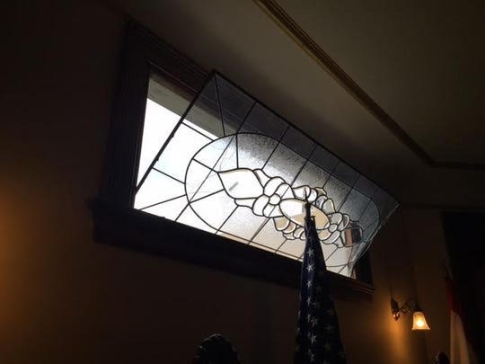A 112 year old window at the Watson House was saved by the flag during Thursday nights storms.