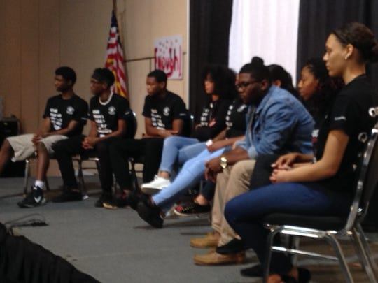"Teens participate in a discussion at the ""Pennies for"