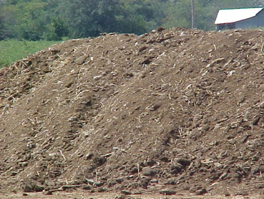 A poultry manure pile awaiting application to a field