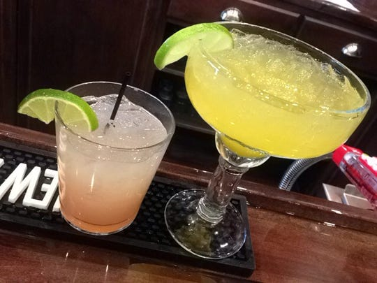 Mango jalapeño margarita (right) and the Pomegranate Paloma with tequila, grapefruit, lime and pomegranate blue agave nectar at Corner Cantina, a Tex-Mex place opening Jan. 28, 2016, in Downtown Indy,