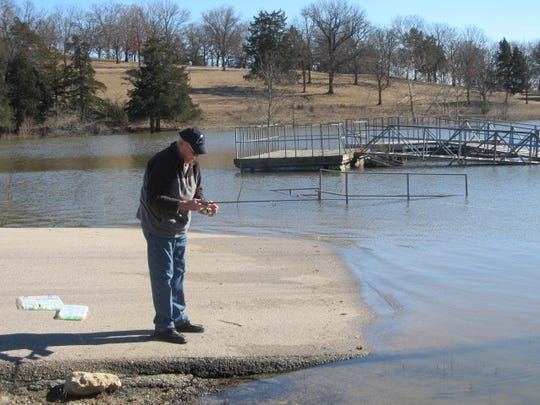 Steve Chapman, Columbia, tests out some lures near the dam at lake Pomme de Terre.