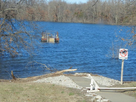 A fishing dock on Stockton Lake is out of reach by anglers who are used to walking out to the dock to fish. High and dingy water has created problems for the anglers.