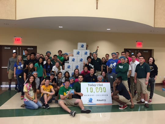 St. John Neumann Catholic High School students helped make 10,000 meals as part of a community project for Feeding Children Everywhere.