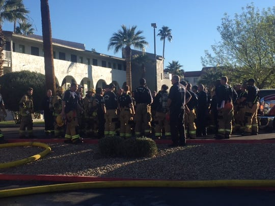 Phoenix firefighters congregate at the scene of an apartment fire on E Indian School Road on Feb. 11, 2016 in Phoenix, Ariz.