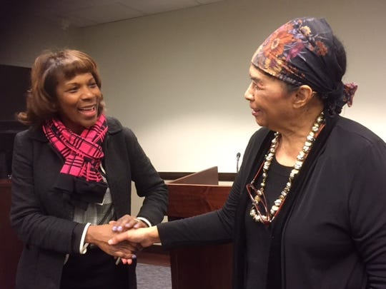 Antoinette Barksdale, a civil rights lawyer at the Justice Department, greets civil rights veteran Dorie Ladner on Wednesday, Feb. 17, 2016 at the department in Washington.