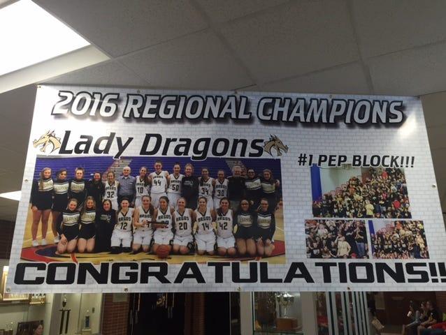 A poster of the Argos girls team inside the school doors.