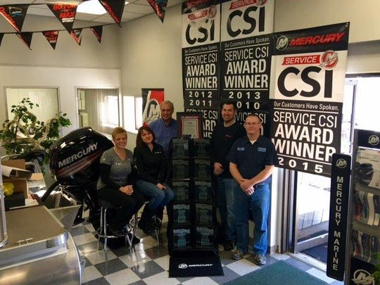 Pictured from left are Debbie Priepke from Mercury Marine, Connie Herzberg from Mr. Marine, Howard Loomans from Mercury Marine and David Sonnenberg and Don Fabris, service technicians from Mercury Marine.