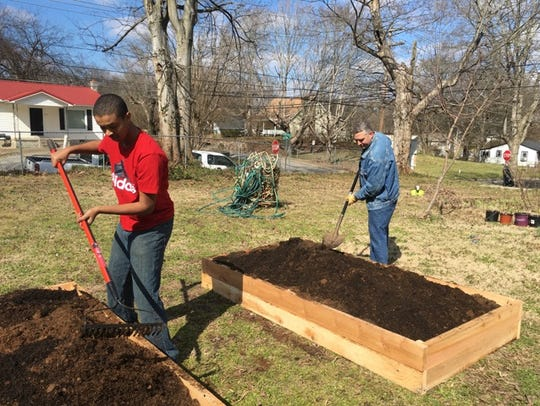 Filling the garden beds with rich and fresh soil.