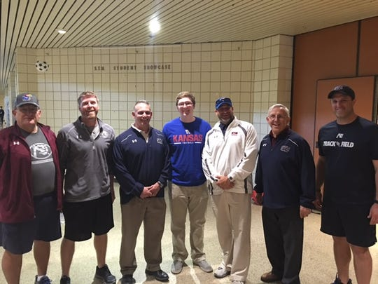 St. Thomas More's Logan Klusman with the Cougars' coaching staff