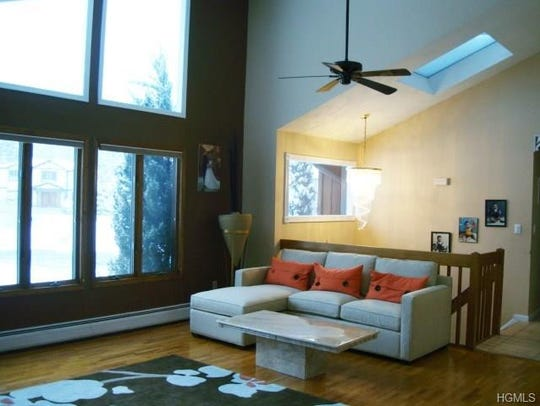 The living room in the bi-level butterfly contemporary