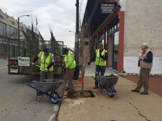 The Richland Community Development Group Beautification Sector planted six new trees downtown on Fourth Street Tuesday paid for by a grant Doug Versaw (at right) received from the Richland County Foundation. Rex landscaping employees Bob Guiler, James Baker and Ryan Hopkins of Rex Landscaping here are shown at work.