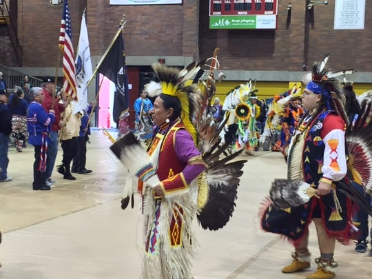 People gather in traditional wear at the 14th annual Native American Pow Wow at Willamette University on Saturday.
