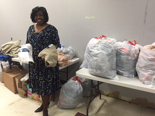 Teachers collecting clothing donations for students