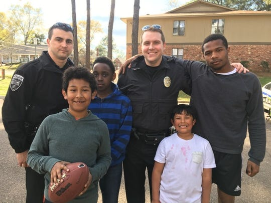 Ridgeland officers Jimmy Finnegan and Jason Haven, along with a group of residents of the Park Place Apartments