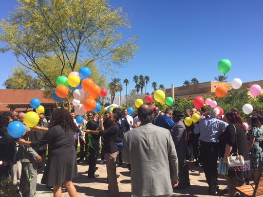 Volunteers and employees pass out balloons for the graduates  to let go into the sky at the Coachella Valley Rescue Mission Thursday. The graduation was for participants who completed the Gateway and New Life programs.