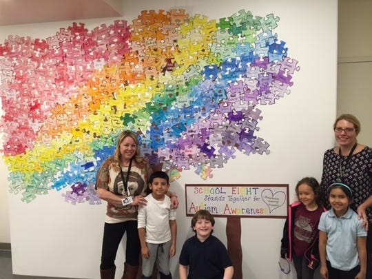 Linden School No. 8 teacher Kim Picciano,   students Mattias Ramirez, Adam Hadidi, Olivia Kramarski, Leslie Garcia and Jennifer Smith, Principal  pictured in front of the Unity Tree.