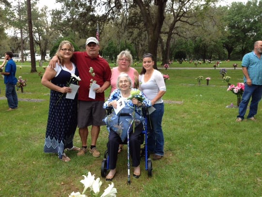 Carolyn Carter with family at graveside
