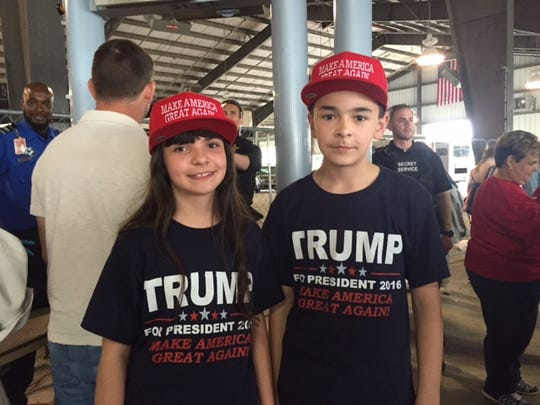 Elizabeth Williams, 11, and her brother, Matthew, 12, of Broomall, Pennsylvania, are shown at a rally for presidential candidate Donald Trump on Friday at the Delaware State Fairgrounds in Harrington.