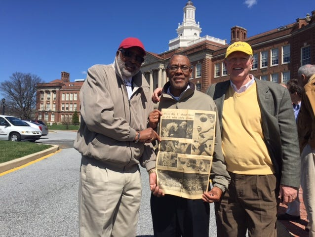 P.S. du Pont 1968 state championship basketball team members (L-R) Ronnie Smith, Clinton Tynes and Randy Johnson with a Morning News picture page from their state-title win. On the other side was a Ku Klux Klan ad.