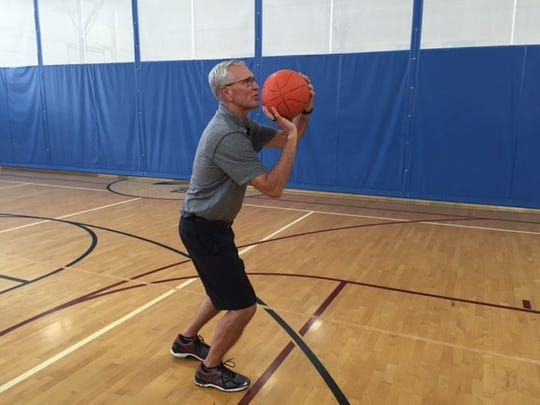 Mike Copper once made 409 consecutive free throws during his lunch hour at Valparaiso. He's shown here at the Benjamin Harrison YMCA in Lawrence.
