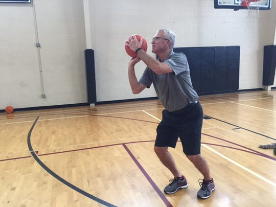 This is Mike Copper. He once made 409 free throws in a row over his lunch hour at Valparaiso High School in February of 1965. This is at the Lawrence YMCA.