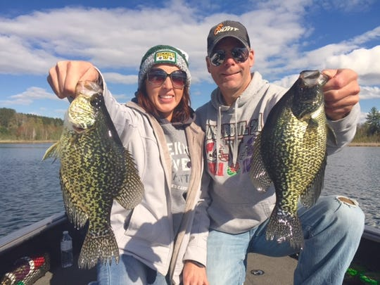 Kala Mueller and Scott Roppe with a pair of nice crappies. The two also got engaged on the trip.