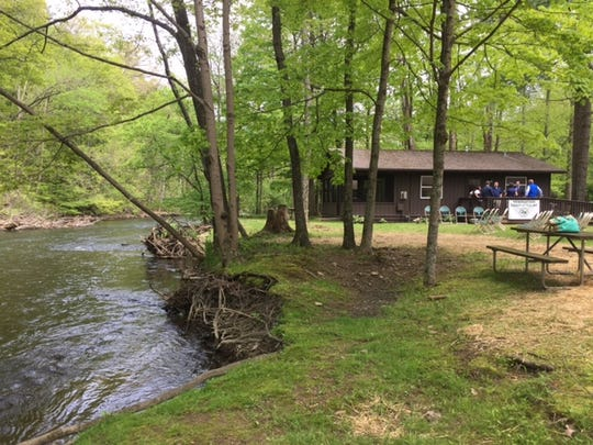 State officials showcased the newly remodeled cabins along the Clear Fork at Mohican State Park Campground on Ohio 3, south of  Loudonville Friday.