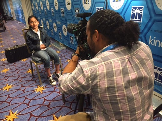 Naysa Modi of Monroe is interviewed by Jarrad Henderson, a multi-media producer at USA TODAY