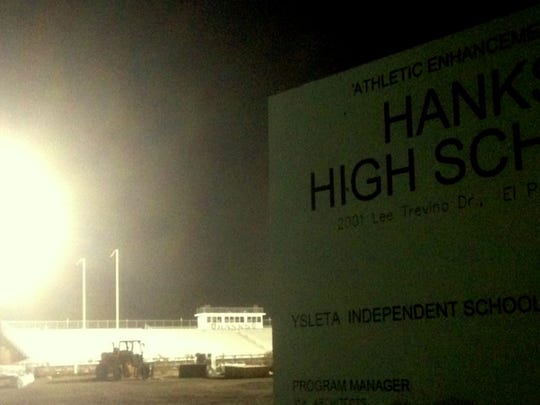 Hanks High School football stadium lights are on nightly to protect newly installed artificial turf.