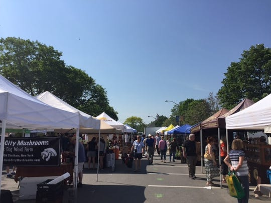 Visitors check out the offerings at the Pleasantville Farmers Market on Saturday.