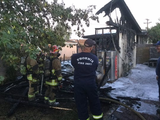 About 20 Phoenix firefighters fought a house fire in the area of 49th and Clarendon avenues on Sunday evening, May 29, 2016. The blaze also damaged power lines.