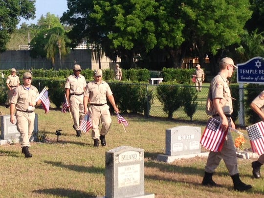 FM Cemetery cadets placing flags