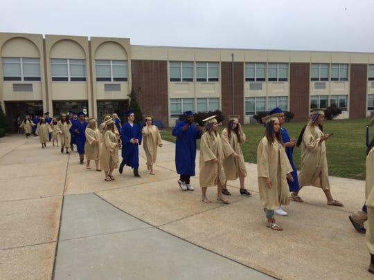 Graduating seniors walk on Friday morning from Buena