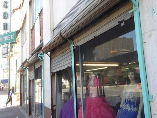 A dress shop is one of two retail tenants in the otherwise vacant, seven-story American Furniture building at Oregon Street and San Antonio Avenue in Downtown El Paso.