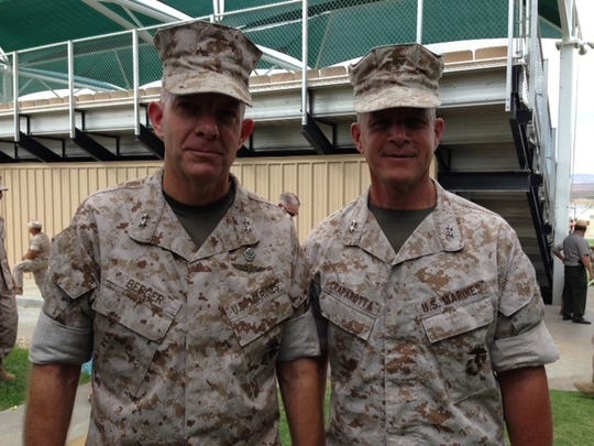 Maj. Gen. David H. Berger (L) and Maj. Gen. Lewis A. Craparotta (left) following change of command ceremony Thursday, July 10, 2014 at Marine Corps Air Ground Combat Center in Twentynine Palms.