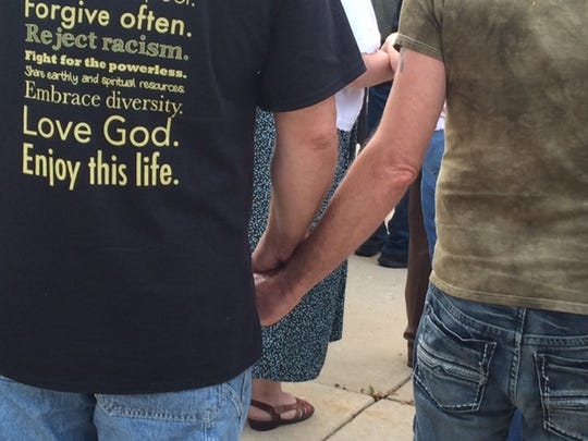Showing unity during a vigil at Union Congregational Church on Monday, June 13, 2016.