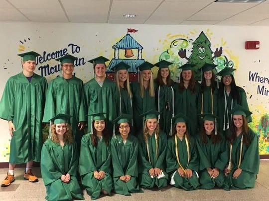 D.C. Everest seniors make a stop at Mountain Bay Elementary School on the way to graduation.