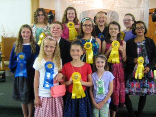 Junior winners from Capital Region 4-H Fashion Revue, left to right, front row, Madison Copenhaver, Lebanon County; Olivia Morrissey, Lebanon County; Sarah Aldrich, Franklin County. In the middle row, Alexandria Neff, Dauphin County; Ethan Snyder, Dauphin County; Sydney Brubaker, Lancaster County; Victoria Greenawalt, Lancaster County; Emily Snyder, Dauphin County. In the back row, Sarah deMackiewicz, Lebanon County; Jolene Bomgardner, Lebanon County; Emma Werner, Lancaster County; Rebekah Aldrich, Franklin County.