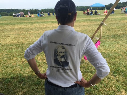 Marjorie Adams shows off her T-shirt with a photo of her great-grandfather, Doc Adams, on it.