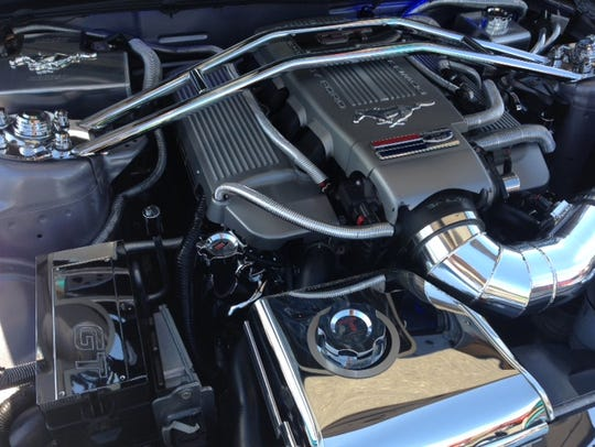 The engine of a vehicle at Sunday's Ayden's Cars for