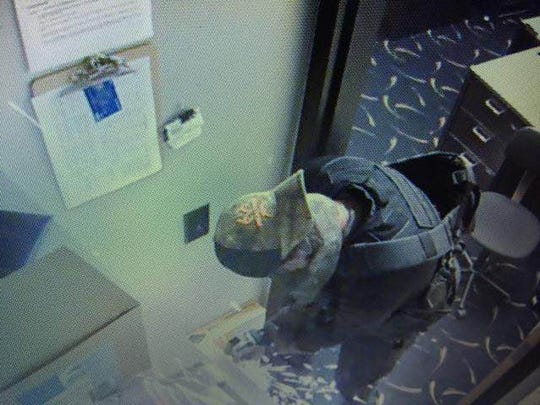 Anyone with information about the July 18 robbery of Manitowoc's Carmike Cinema should contact the Manitowoc Police Department Detective Bureau at 920-686-6585, the shift commander at 920-686-6551 or Crime Stoppers at 920-683-4466. Pictured is the suspect in a surveillance video still from the robbery.